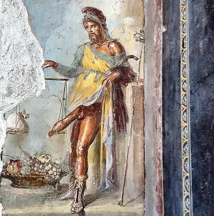 Il Priapo affrescato sull'uscio della Casa dei Vettii - Image by Parco Archeologico di Pompei
