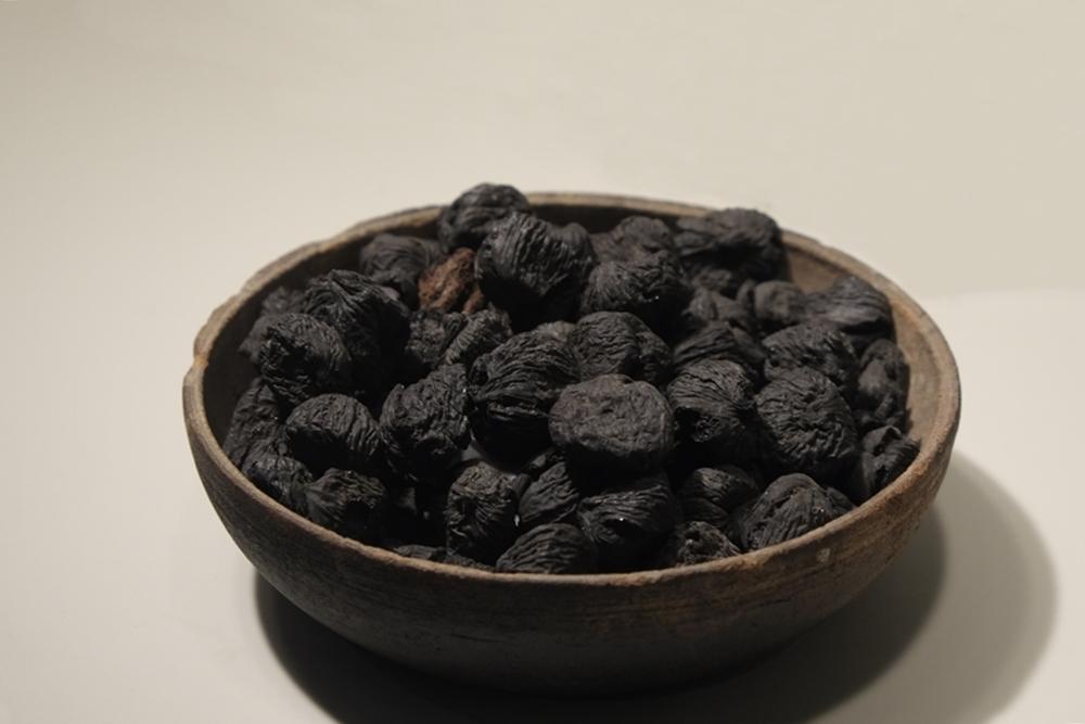 Fichi secchi interi (Ficus carica L.) carbonizzati,  Pompei regio VII insula 4. Bottega