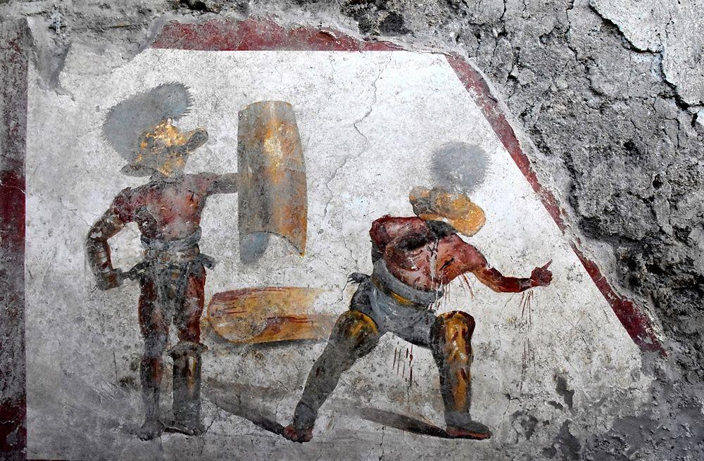 Gladiatori in combattimento, l'affresco del I sec. d.C. ritrovato a Pompei, nella Regio V