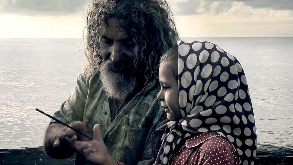 La piccola Maria con il nonno pescatore