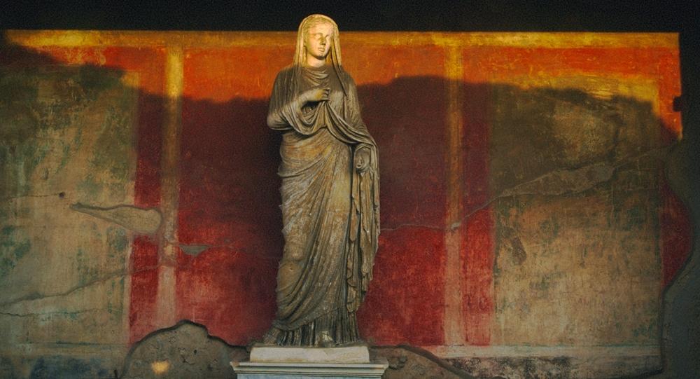 Statua e ambiente pompeiani